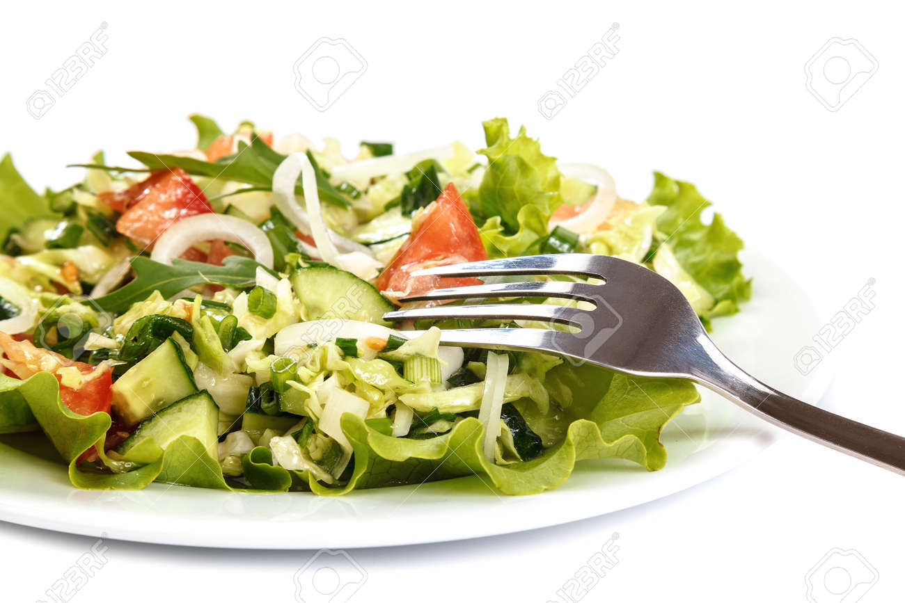 Fresh vegetable salad isolated on a white background. - 156194032