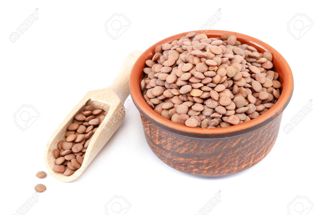 Grains of lentils in a bowl isolated on a white background. - 154785875