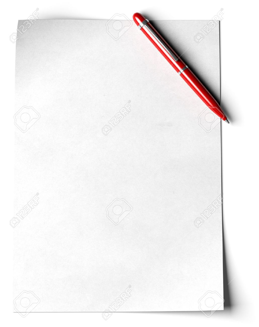 blank page with a red ball point pen in the angle of the page over white