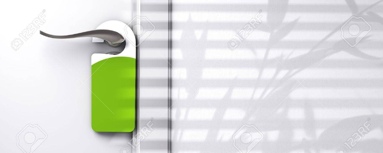 green blank plastic door hanger fixed onto a knob, wall with free space, room for text, shadow of a plant, real estate or hotel communication concept Stock Photo - 13168846