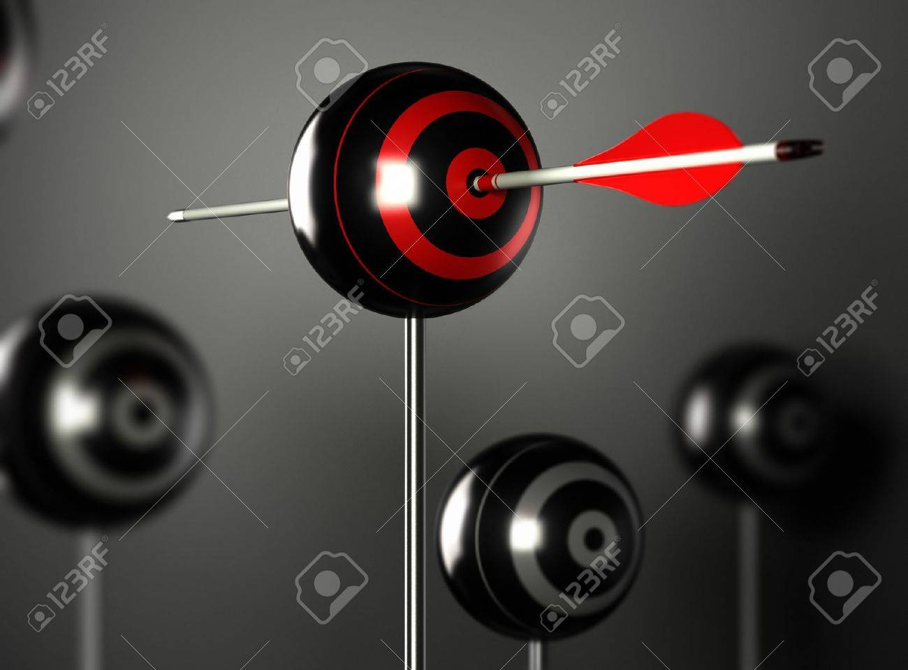 one red arrow hitting the center of a ball target with other blur targets around, black background with light effect Stock Photo - 18860468
