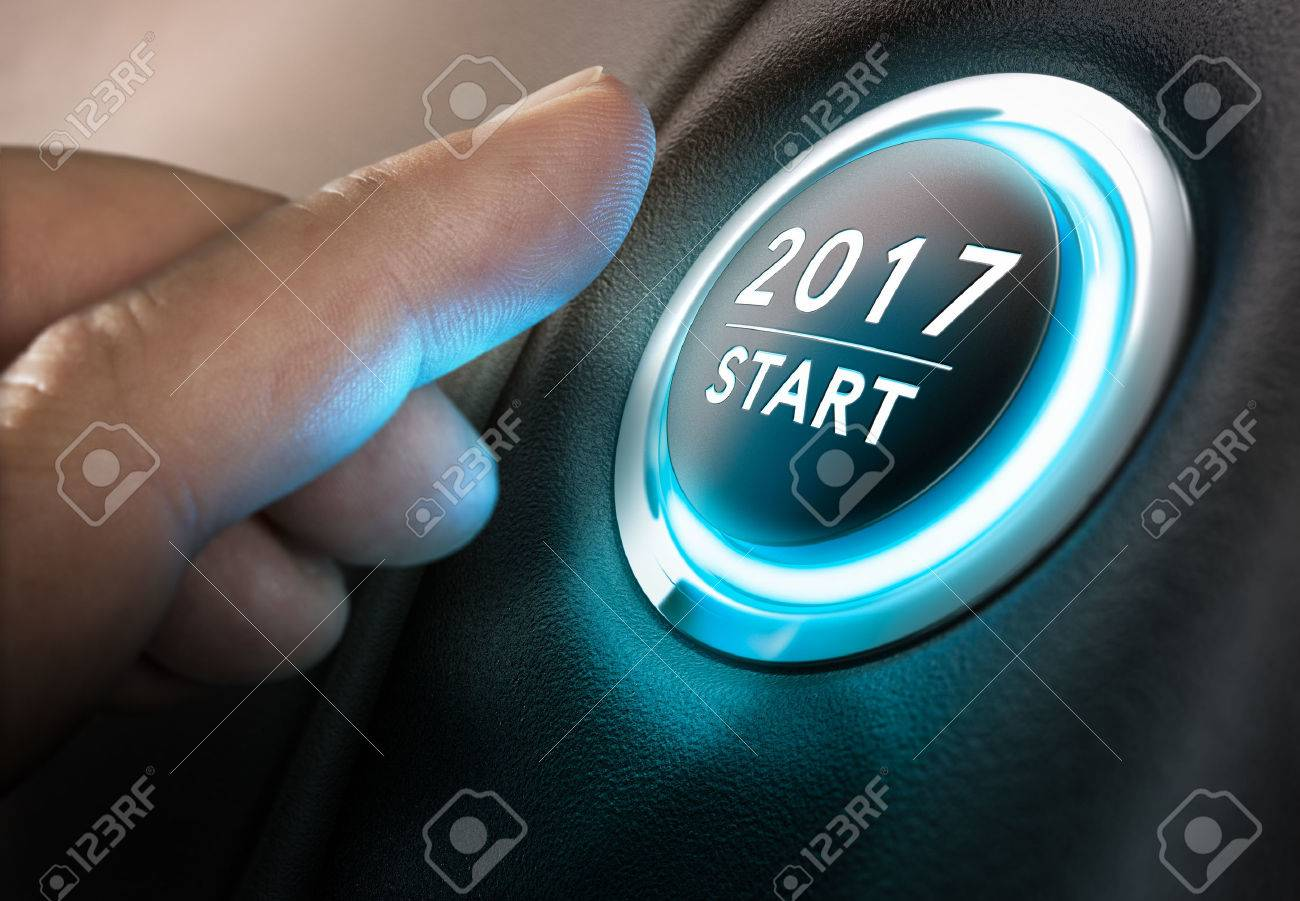 Hand about to press a start button 2017. Concept of new year, two thousand seventeen. Composite between photography and: has a 3D background. horizontal Image - 67643322
