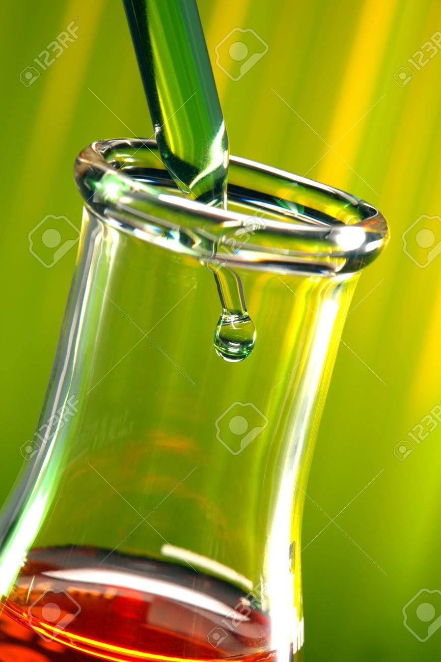 Pipette with emerging drop in an Erlenmeyer flask Stock Photo - 1455866
