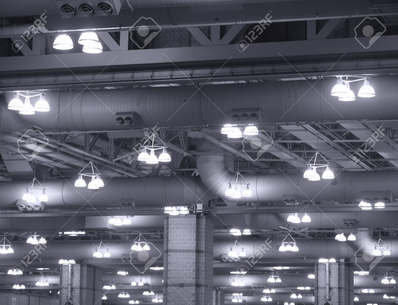 the latest bc7be 41f8c Overhead hanging lights in an industrial building