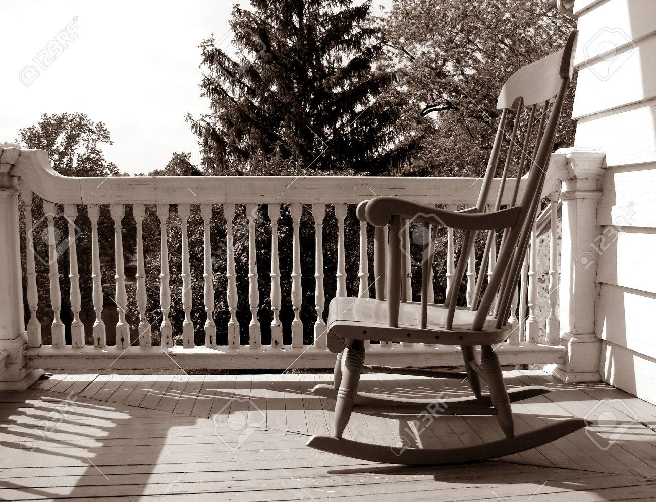 Antique rocking chair black - Antique Rocking Chair Rocking Chair On An Old House Porch