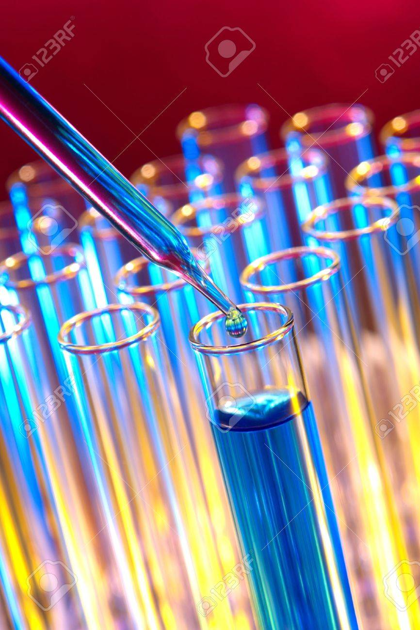 Pipette with emerging drop over test tubes in a research lab Stock Photo - 3144669