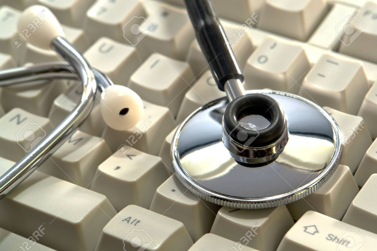 Medical doctor stethoscope on computer keyboard Stock Photo - 5149261