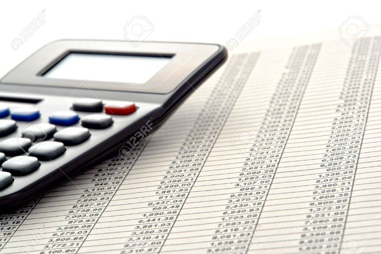 Financial Figures Spreadsheet With Rows Of Numbers And Calculator ...