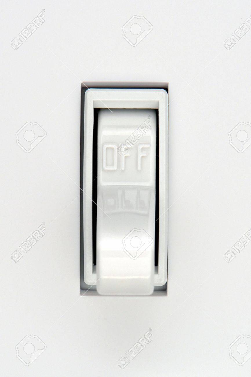 Traditional North American toggle electric light switch in OFF