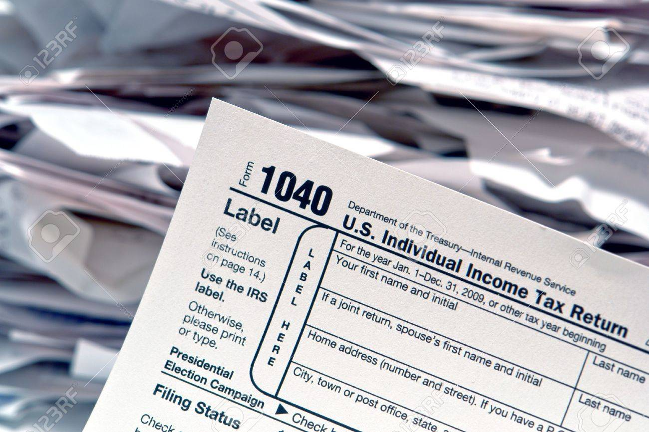 American Irs Internal Revenue Service Individual Income Tax Form 1040 At  Filing Time With Pile Of Canadian Tax Form