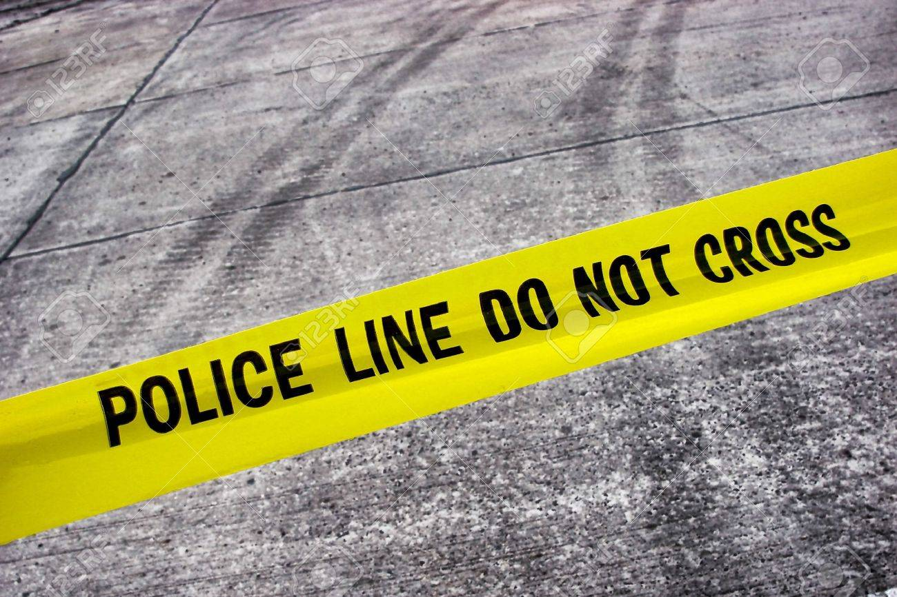 Street crime scene with police line do not cross yellow warning tape above road with tire tracks Stock Photo - 7298554