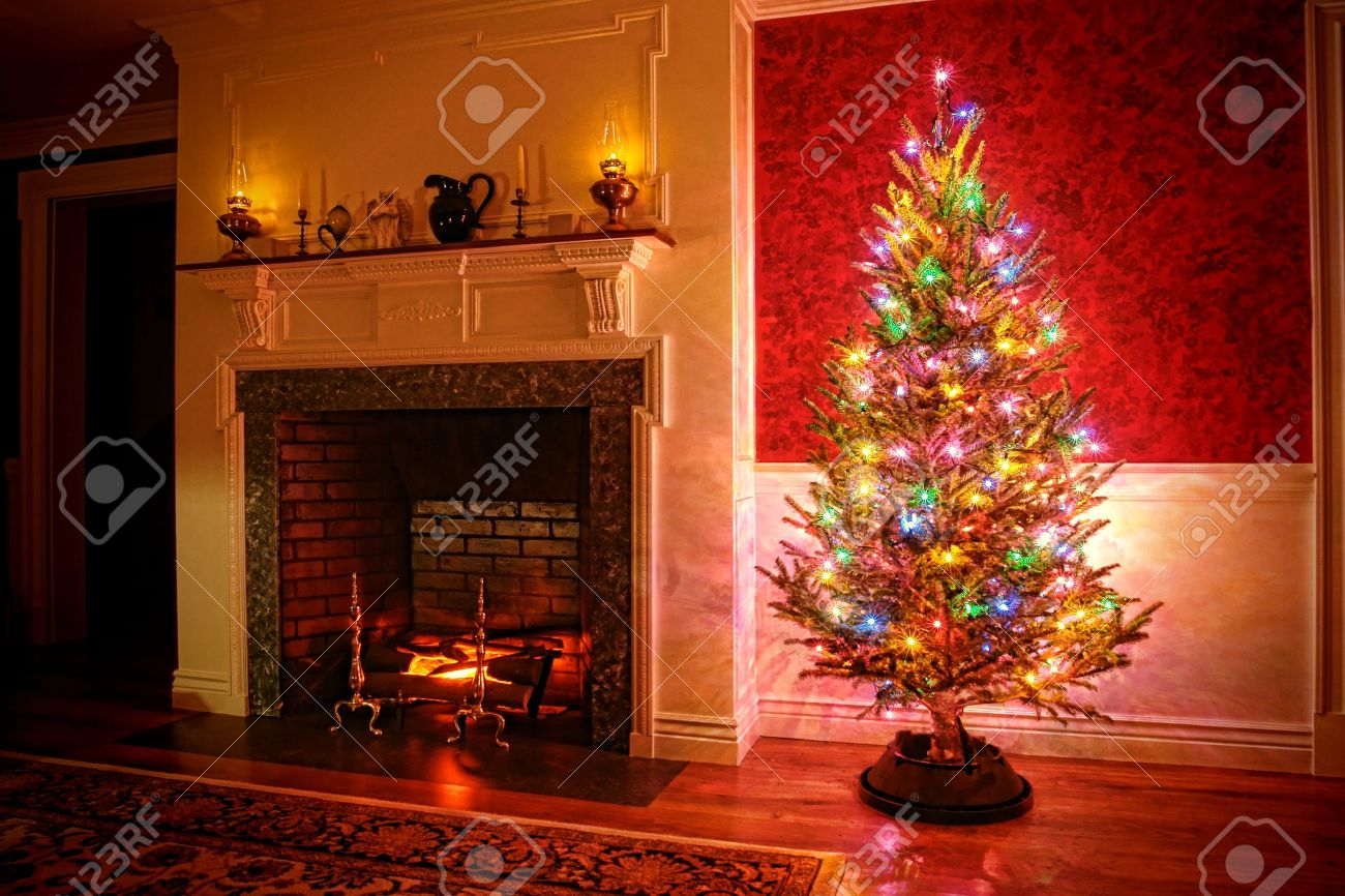 christmas tree with vintage multi color lights in an old fashioned traditional interior with brick fireplace - Old Fashioned Christmas Tree Lights