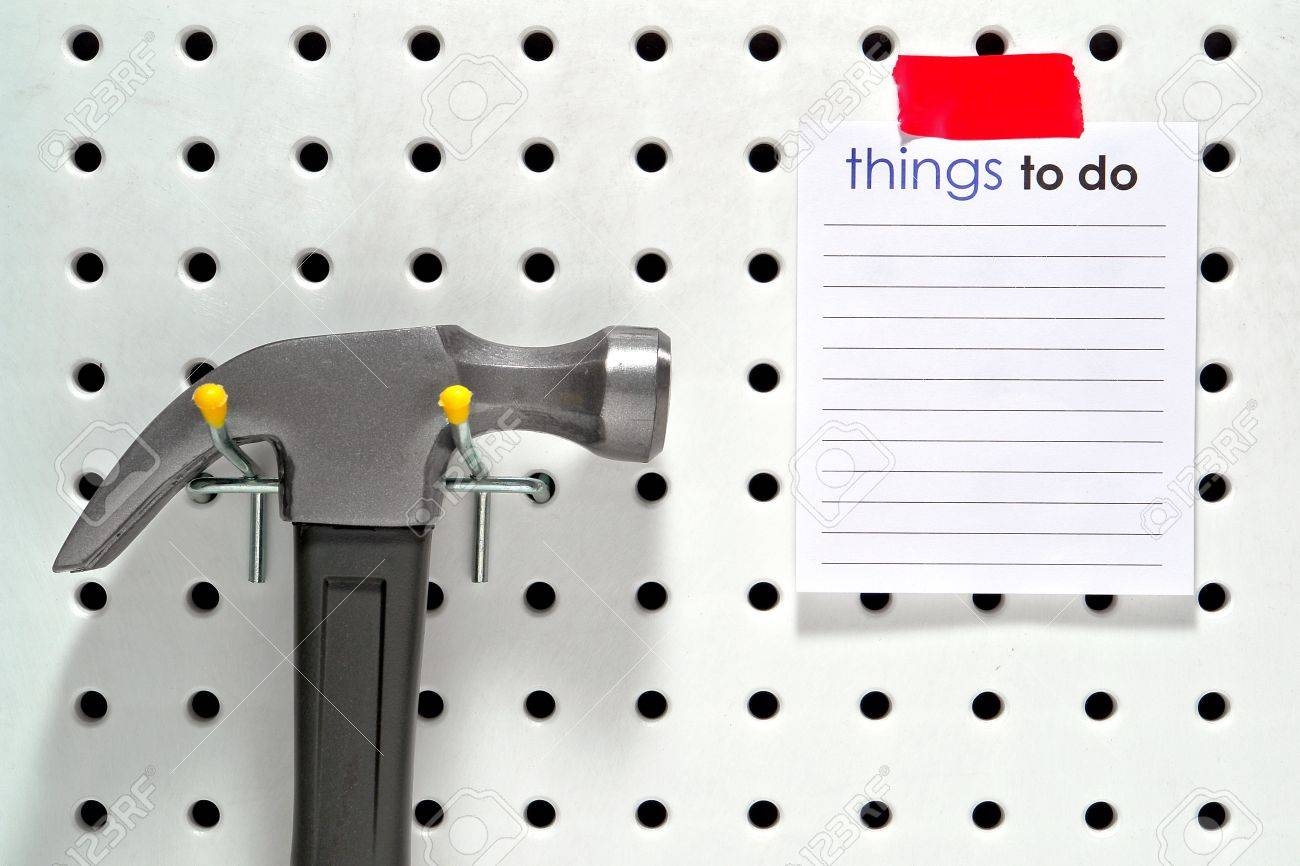 Handyman things to do project list on a blank notepad leaflet with flat copy space for text insert on a home workshop tool pegboard with hanging construction hammer Stock Photo - 10254941