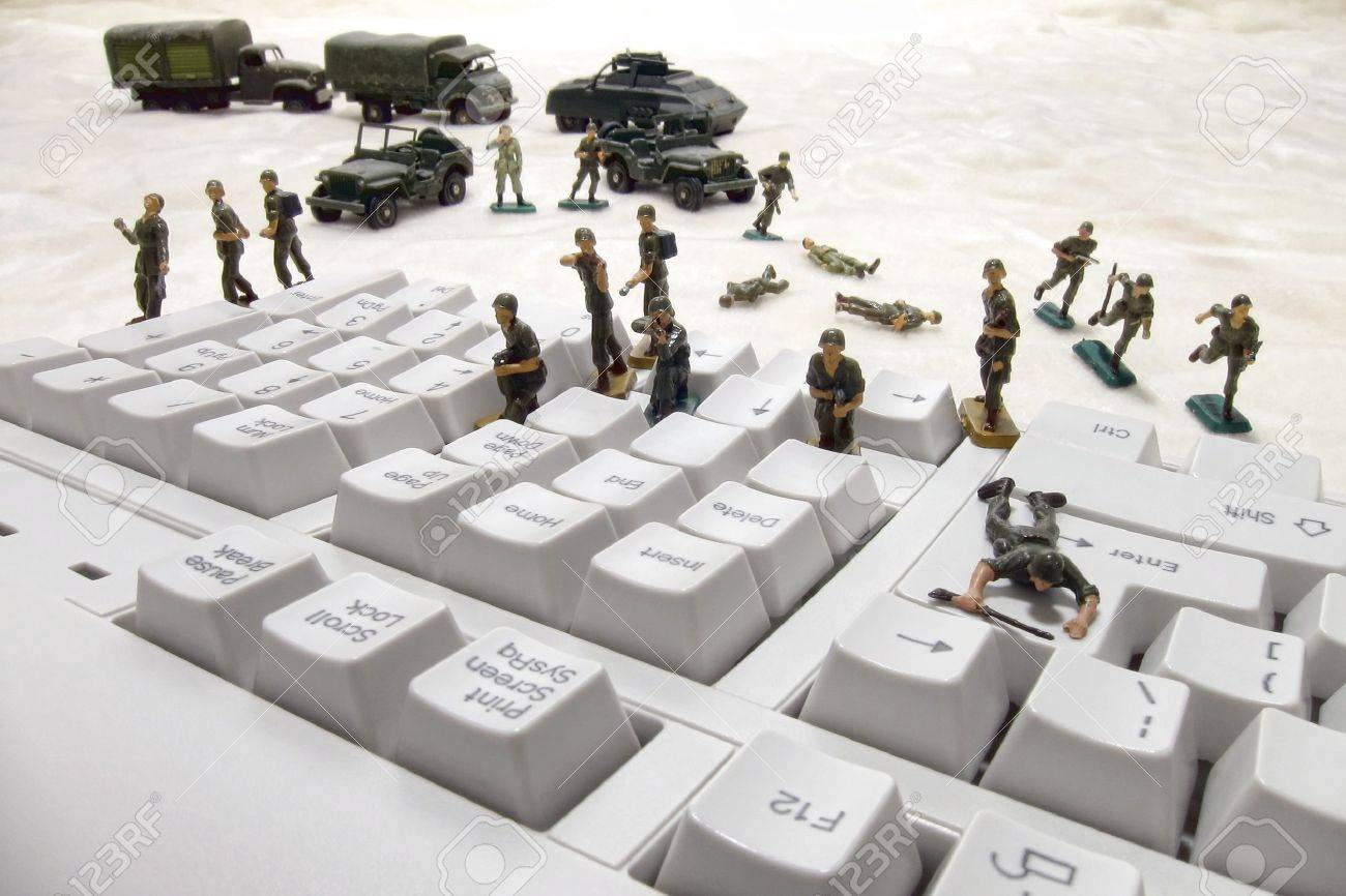 Invading force of miniature army toy soldiers in an attack on a computer keyboard as a metaphor for the risk of virus and worm infection in internet or network security Stock Photo - 10266325
