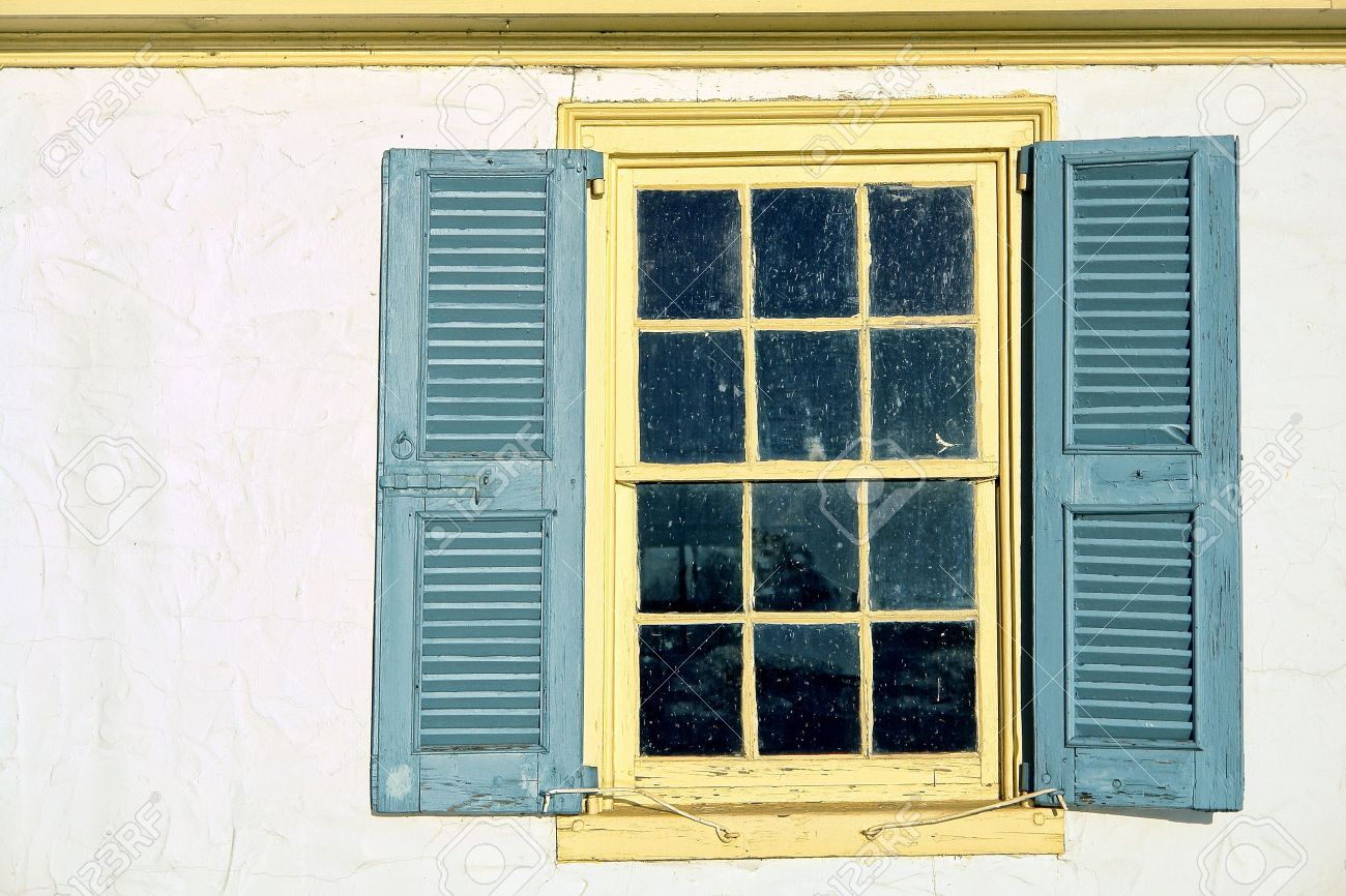 Old Antique Window With Leaded Glass Panes And Vintage Wood Shutters