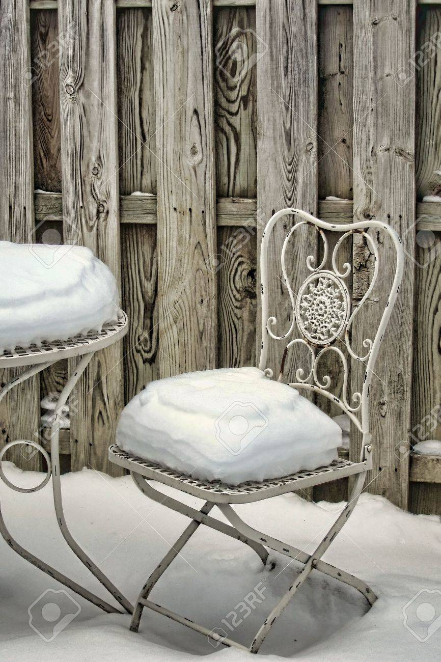 Decorative garden furniture   Decorative White Metal Garden Chair And Table  Covered With Snow In A. Decorative Garden Furniture