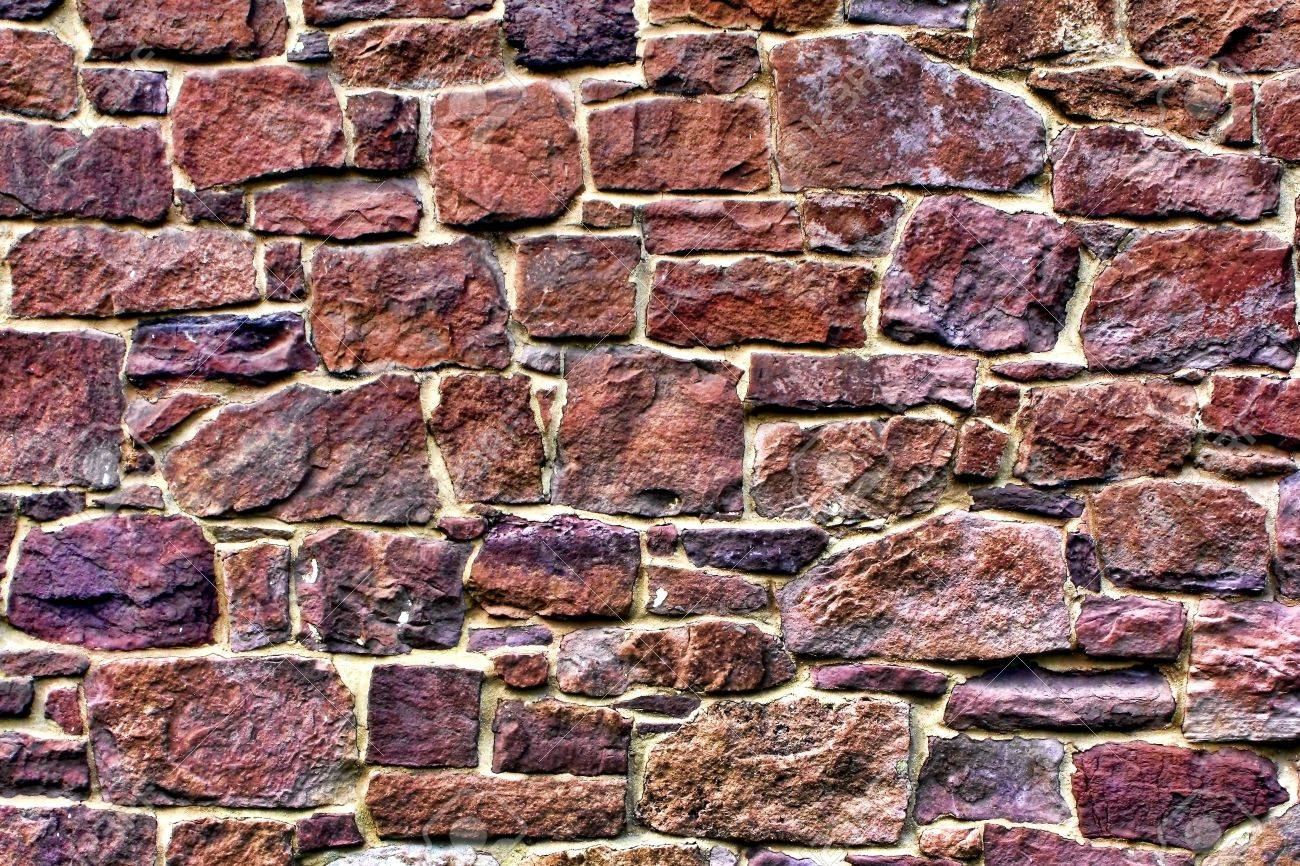 Old house stone wall made of randomly stacked red blocks with mortar joints Stock Photo - 10287075