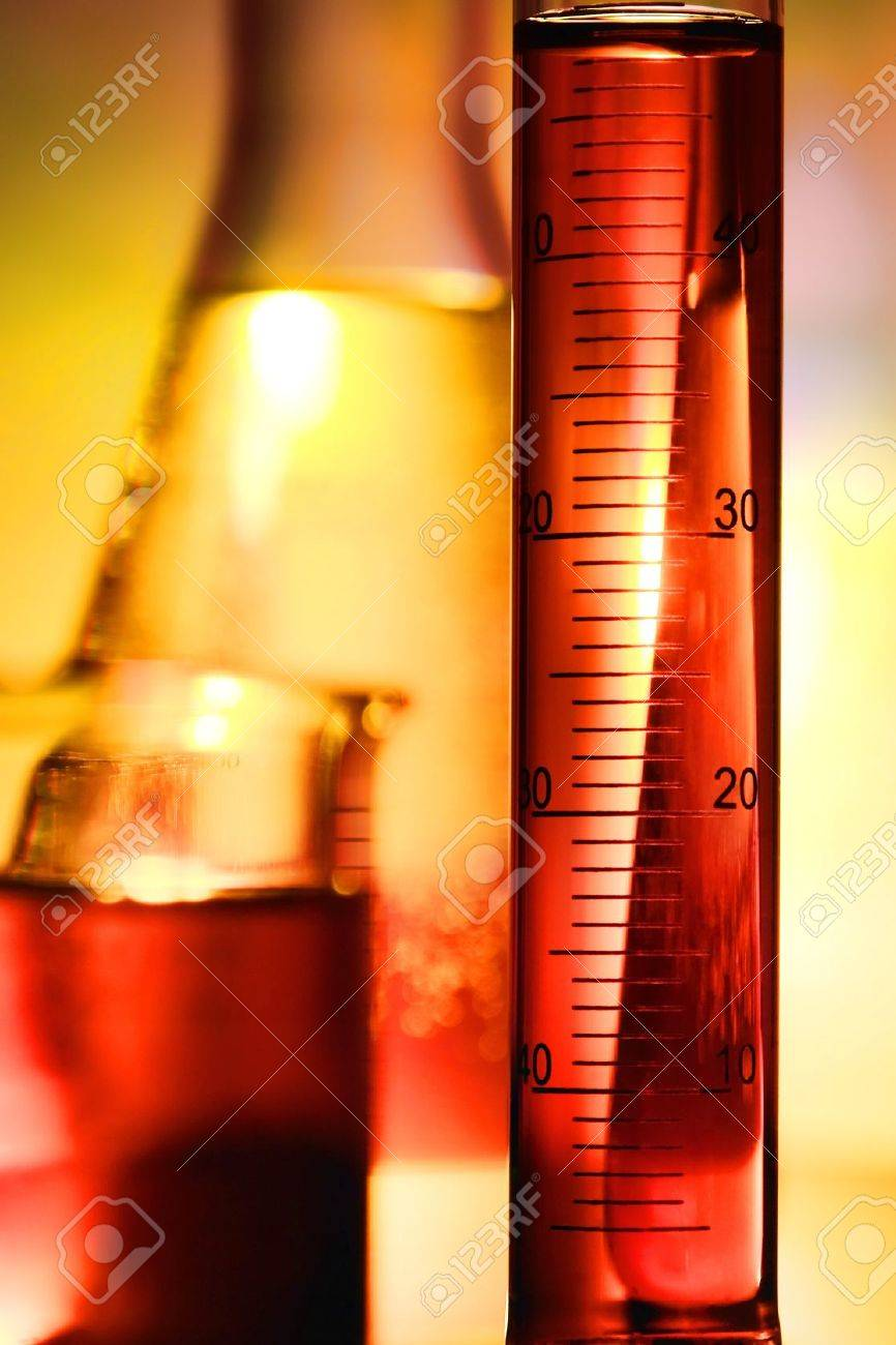 Scientific graduated cylinder filled with liquid for an experiment in a science research lab Stock Photo - 10461959