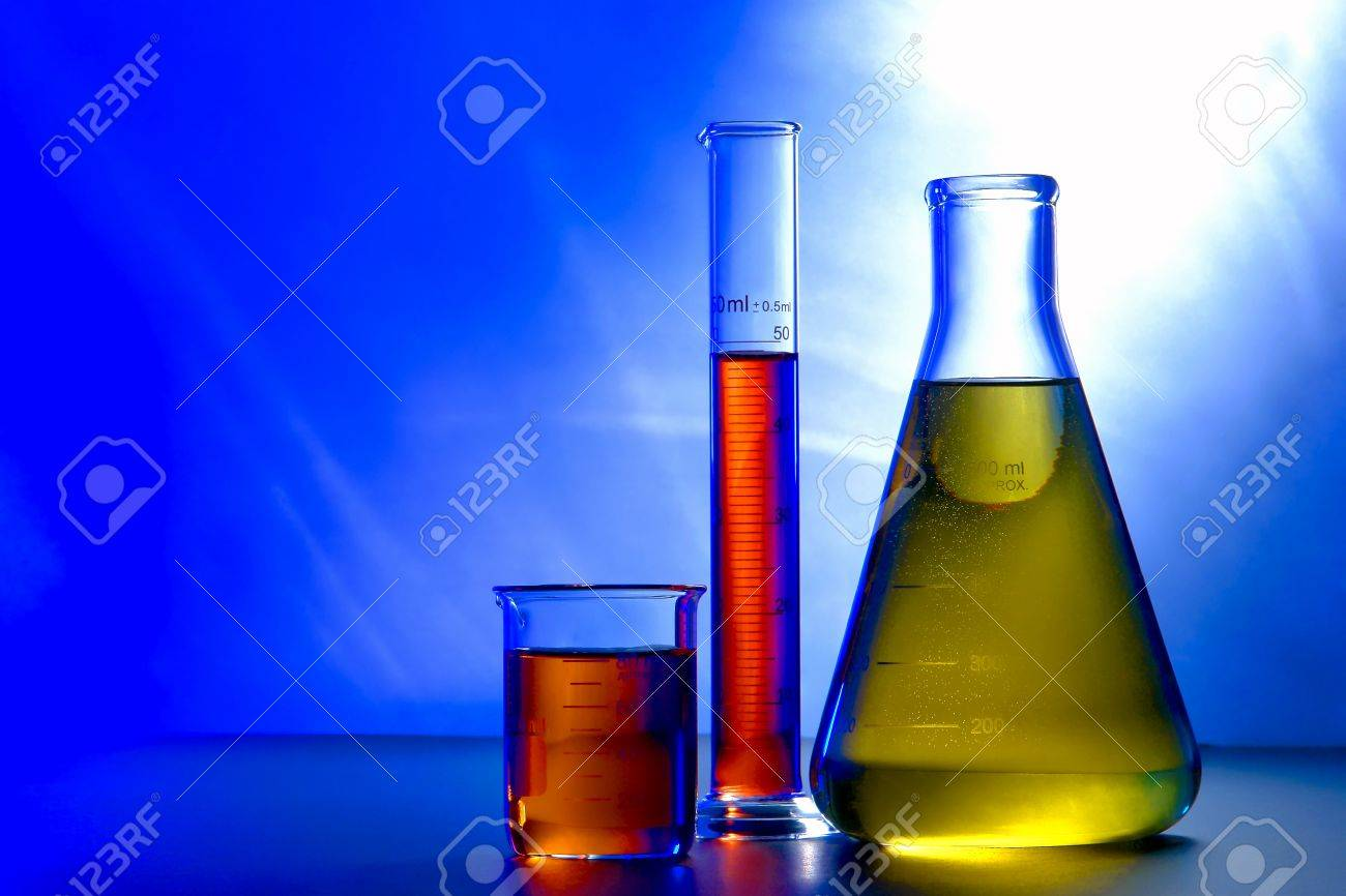 glass erlenmeyer flask with beaker and graduated scientific cylinder