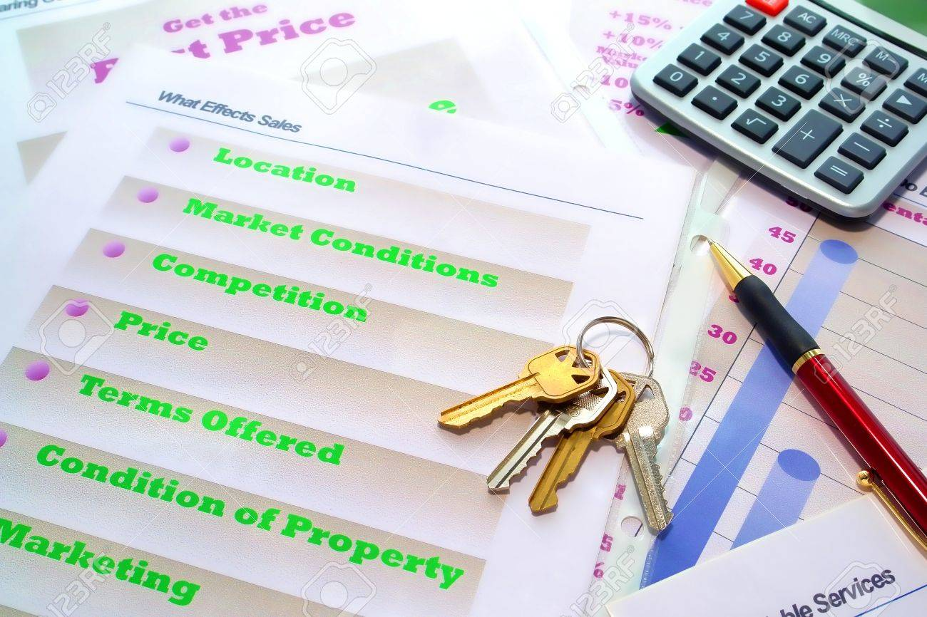 set of house keys and calculator on real estate agent marketing set of house keys and calculator on real estate agent marketing plan binder loose demonstration