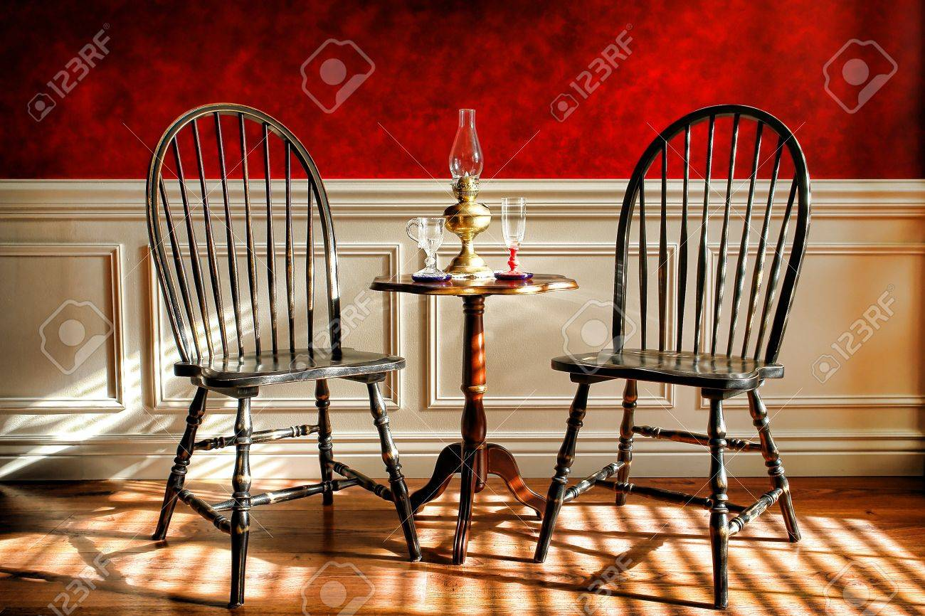 antique black distressed windsor style chairs and mahogany table