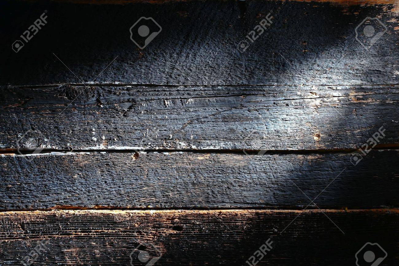 Old and distressed antique charcoal smoked burned board made of barn wood plank with rough weathered textured grain grunge background Stock Photo - 12543341