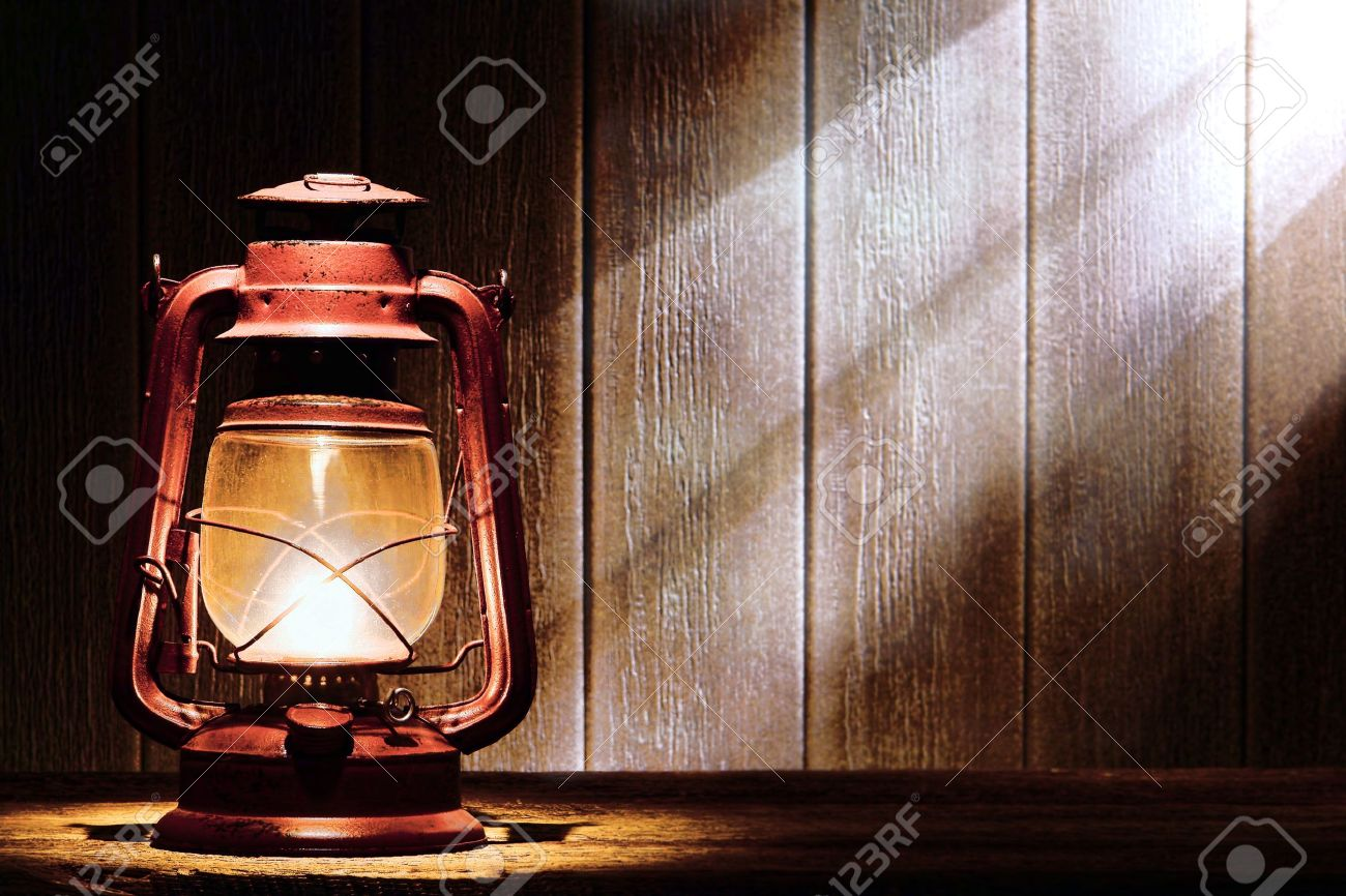 Old Fashioned Kerosene Lantern Style Oil Lamp Burning With A Soft Glow Light In An Antique