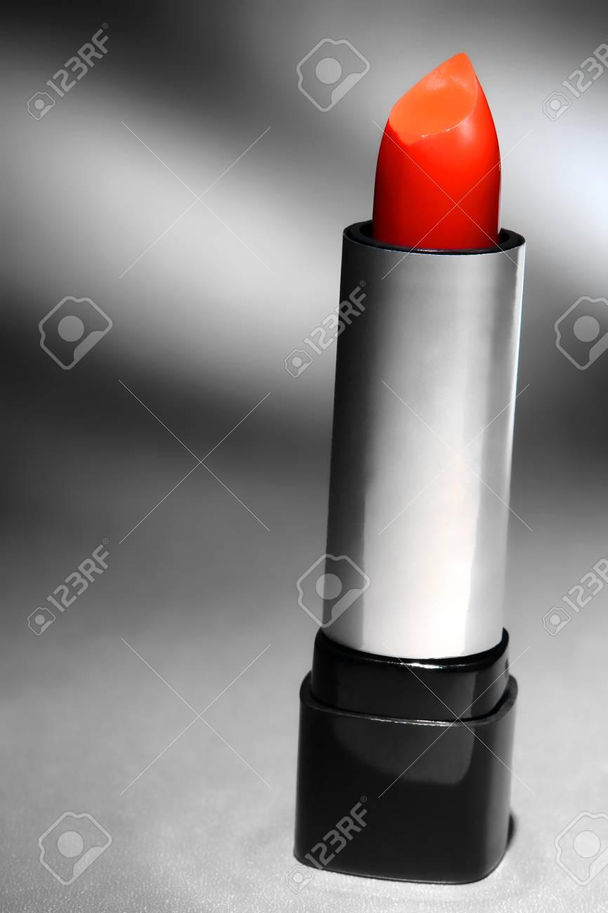 Elegant tube of beauty red lip gloss lipstick cosmetics makeup on shiny metallic silver surface Stock Photo - 12837829