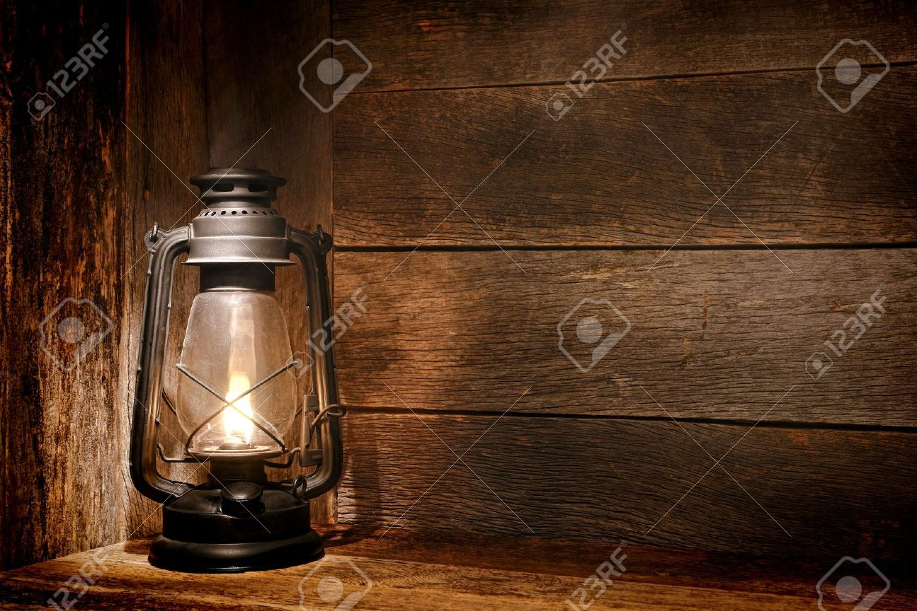 Old Fashioned Vintage Kerosene Oil Lantern Lamp Burning With A Soft Glow  Light In An Antique