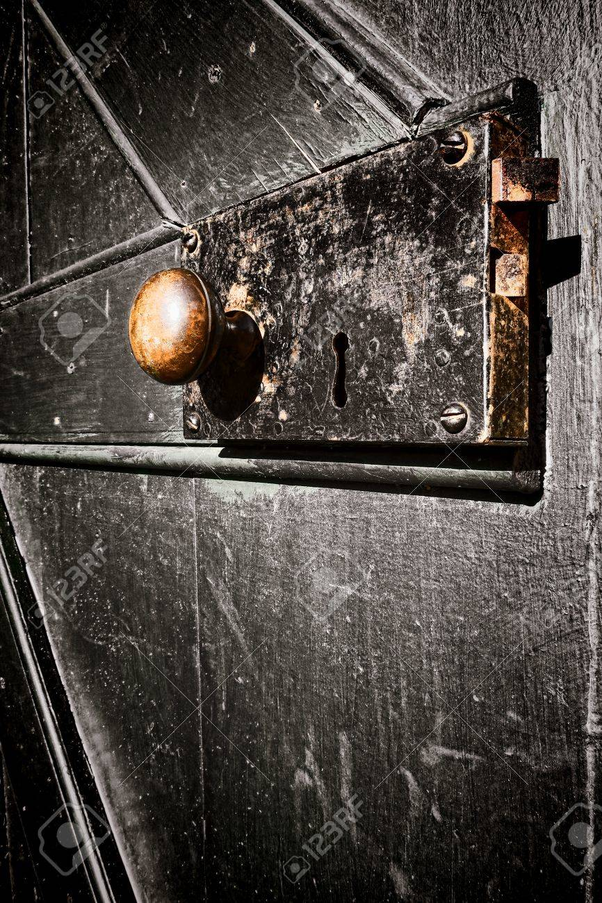 Antique Door Lock With Keyhole And Worn Brass Knob On Aged Rusty Escutcheon  Plate On An