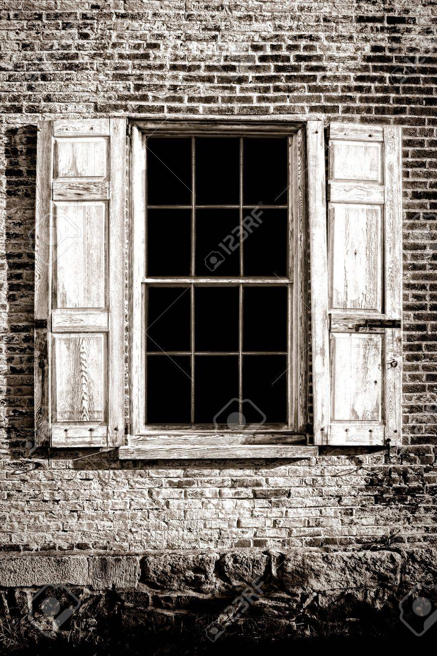 Old Antique Window With Ancient Glass Panes And Broken Wood Shutters
