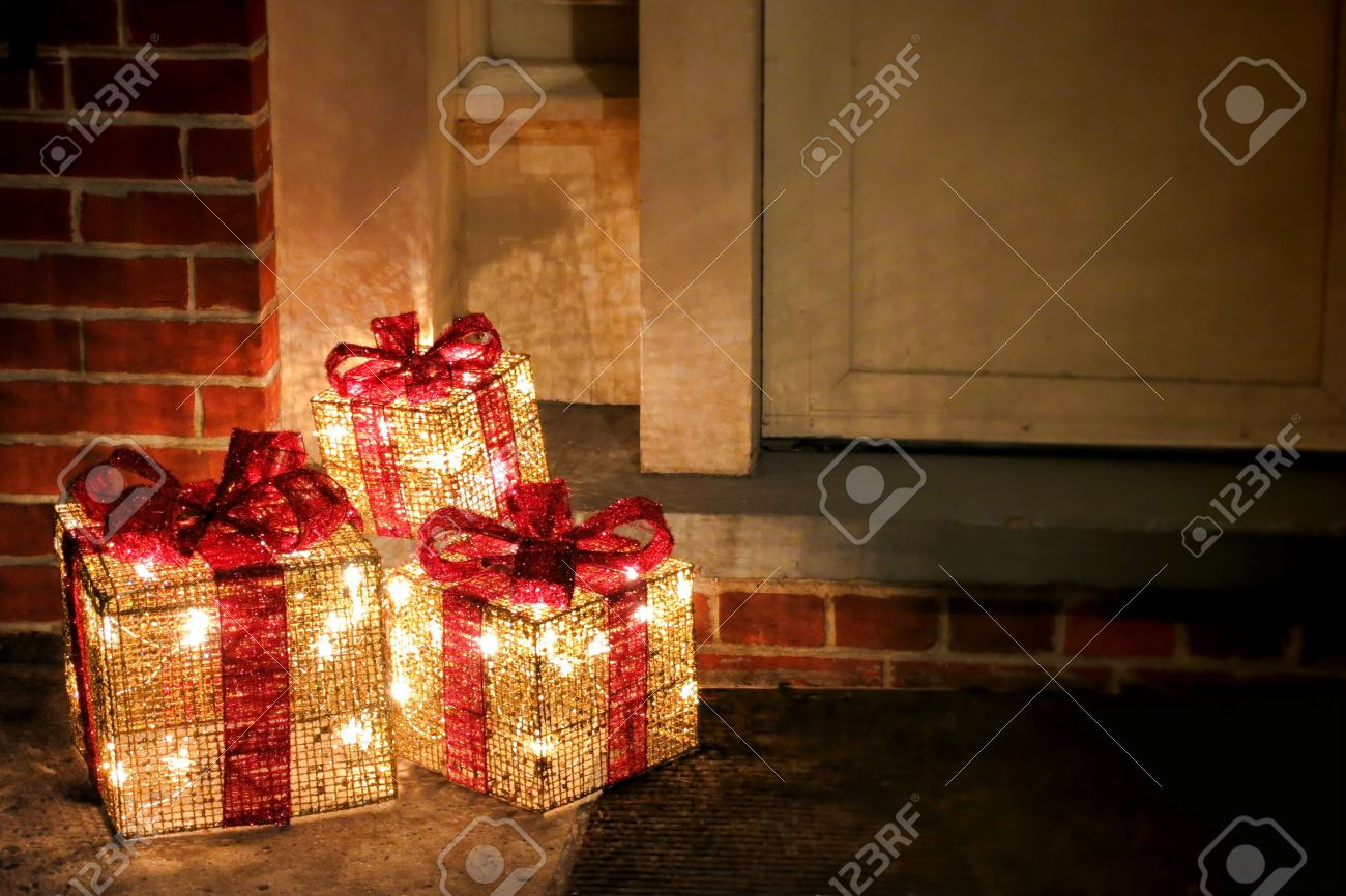 Lighted Decorated Christmas Gift Boxes With Red Bows And Festive ...
