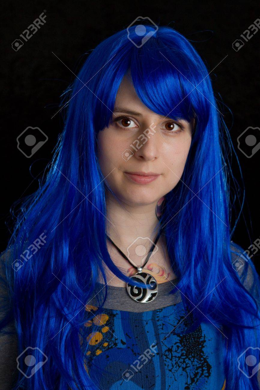 a caucasian woman wearing a funny blue wig Stock Photo - 13873756
