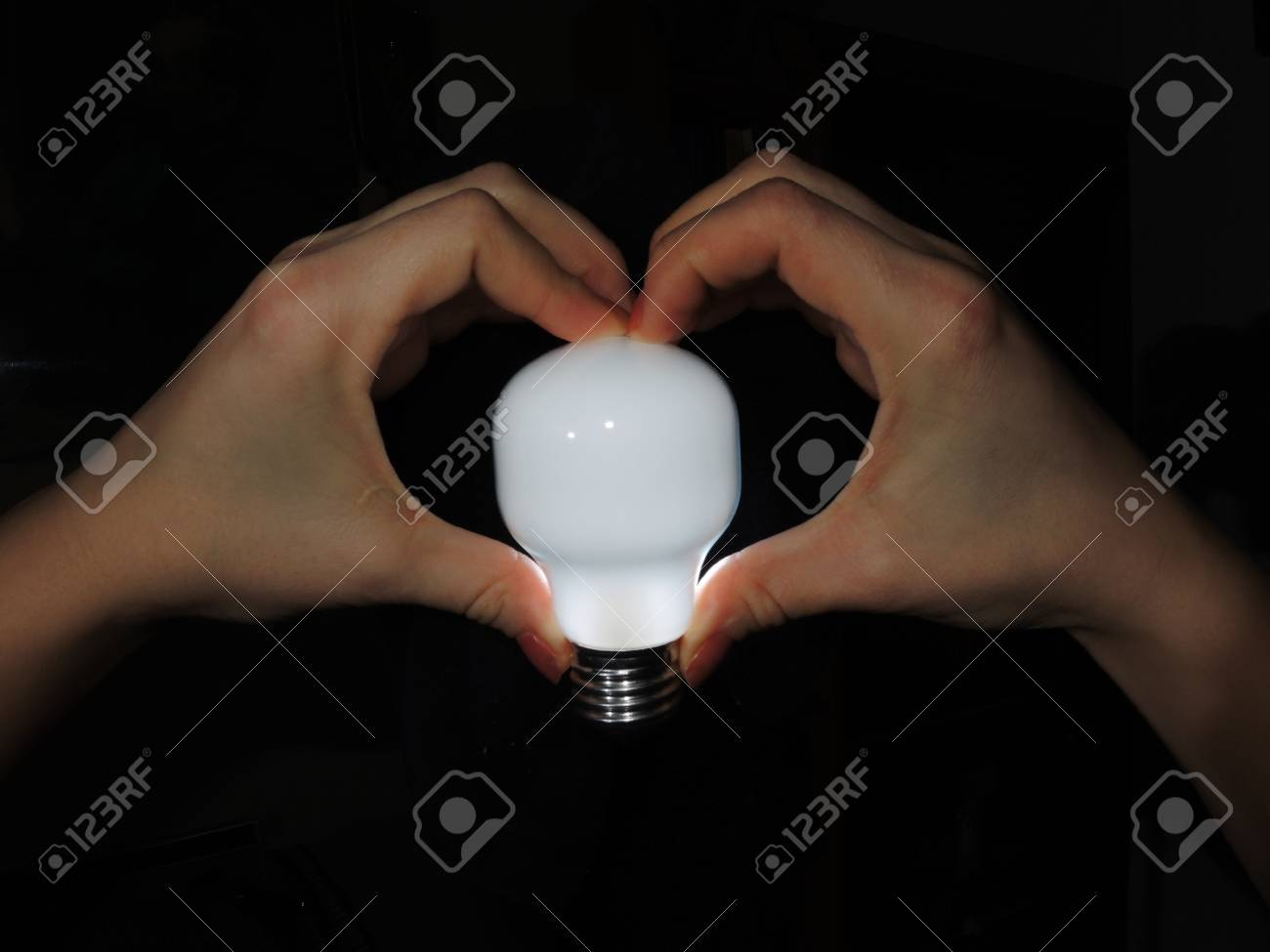 The bulb is ignited in a hands Stock Photo - 17995031