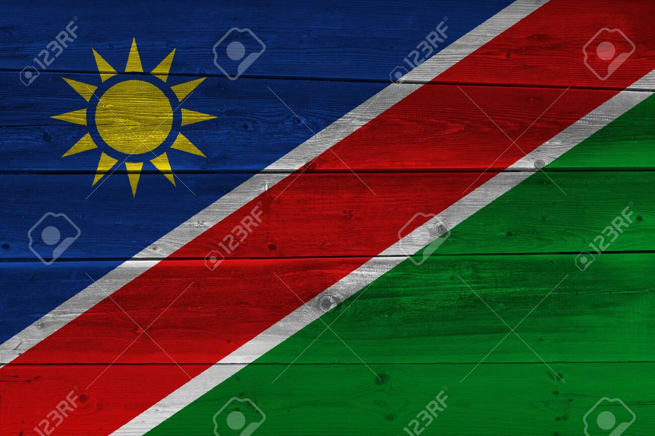 Namibia flag painted on old wood plank  Patriotic background