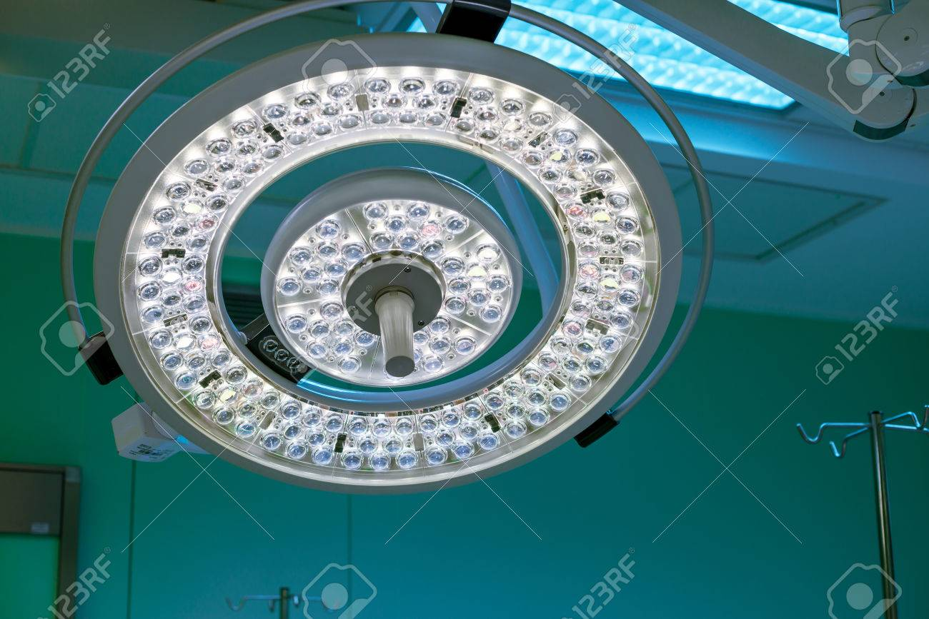 Stock Photo   Surgical Lamp In Operation Surgery Room. Half Brightness.  Green Cast Light Is On Background Open During The Surgery.