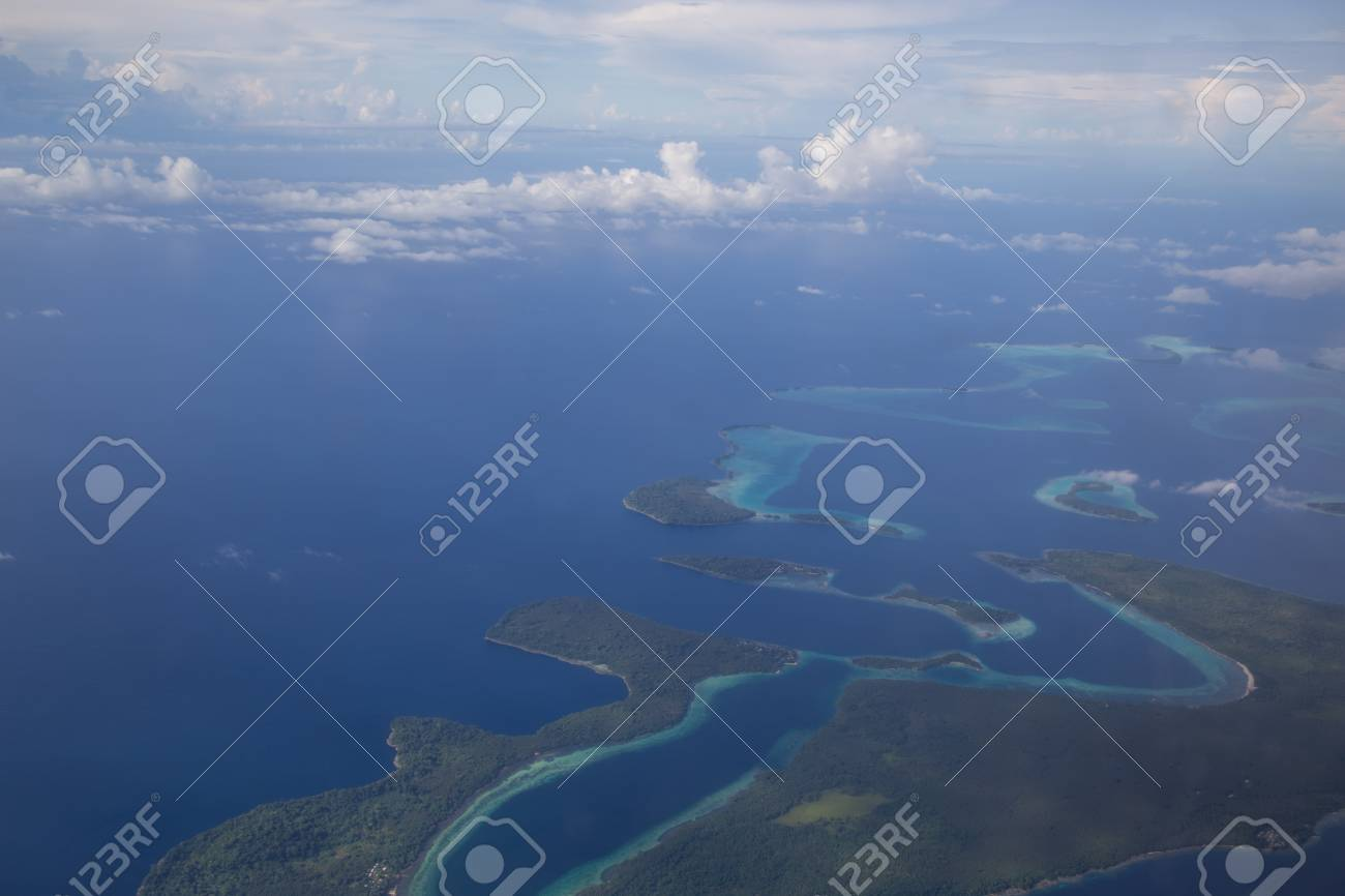 Aerial view photograph of small islands in the Solomon Islands. - 58374665