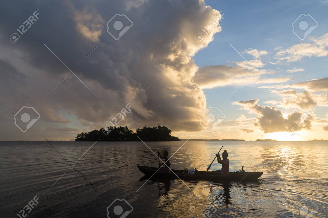 Children on the way to school with a canoe during sunrise in the Solomon Islands. - 59205900
