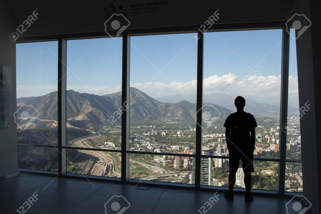 Silhouette of man enjoying view from Gran Torre Santiago in Santiago de Chile. - 60190781