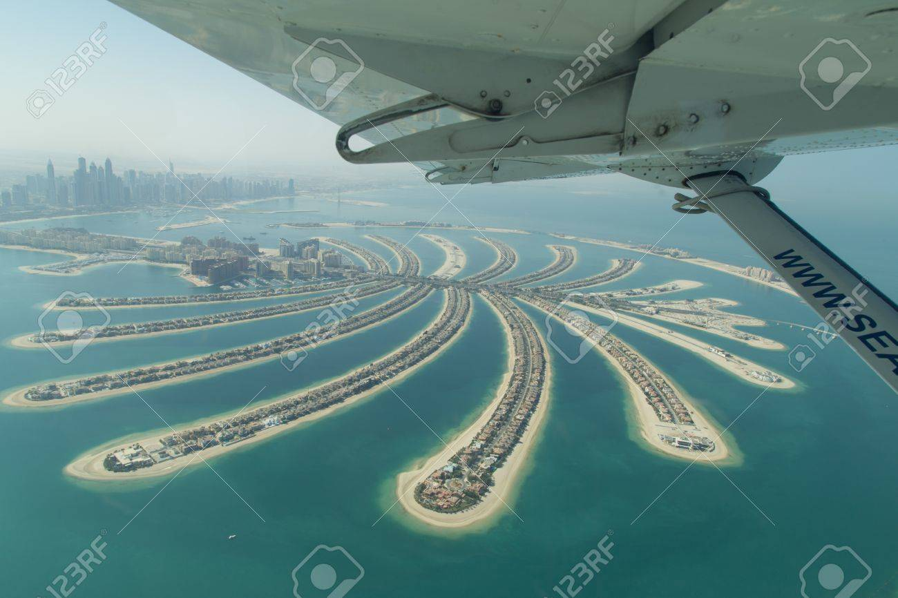 Dubai, United Arab Emirates - October 17, 2014: Aerial view of the artificial island Palm Jumeirah from a seaplane. - 58095926