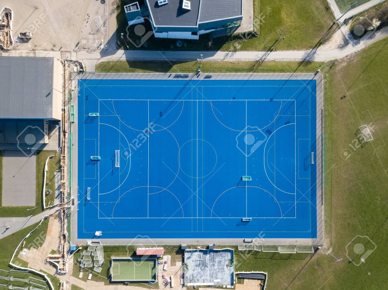 Valby, Denmark - March 22, 2020: Top down aerial drone view of a blue soccer field. - 144115455