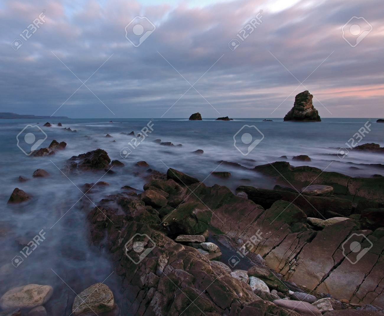 Twilight over Mupe Bay on the Jurassic Coast Dorset Stock Photo - 11926311