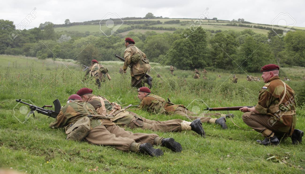 British world war 2 troops in action with american troops in the back ground Stock Photo - 14223412