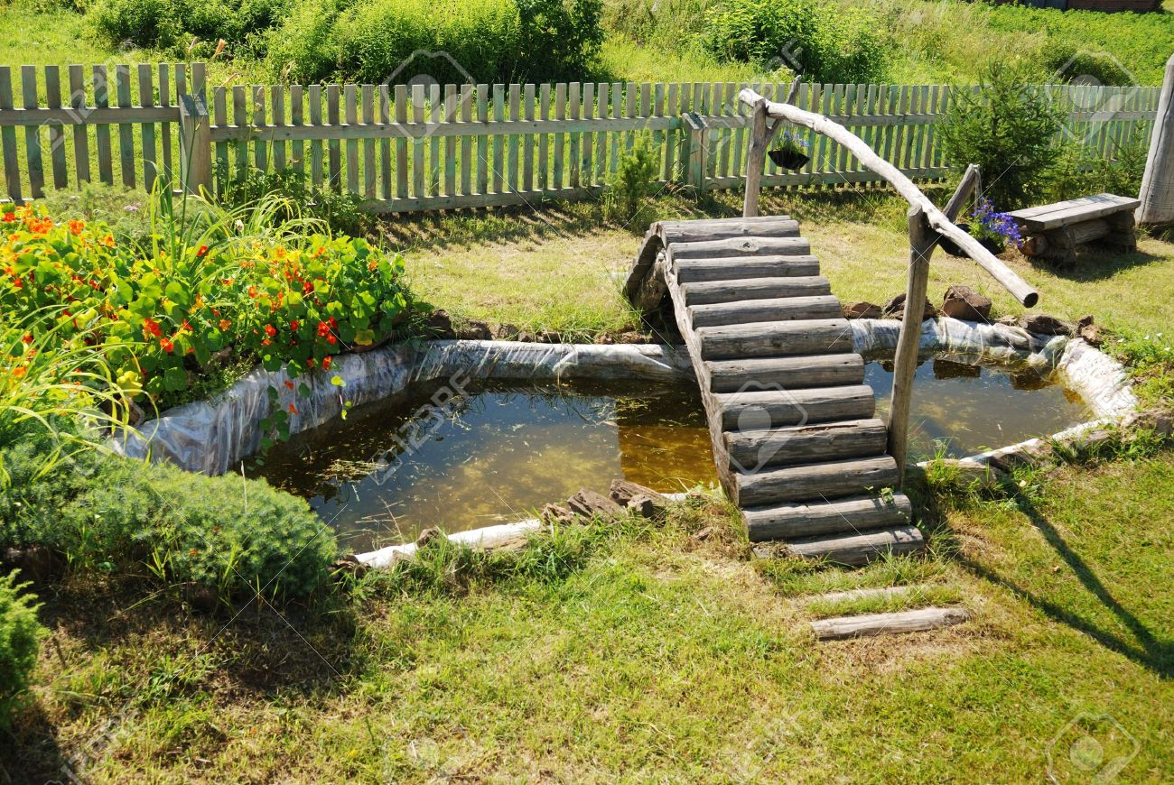 Small Garden Pond With Wooden Bridge In Summer Stock Photo Picture And Royalty Free Image Image 11262522