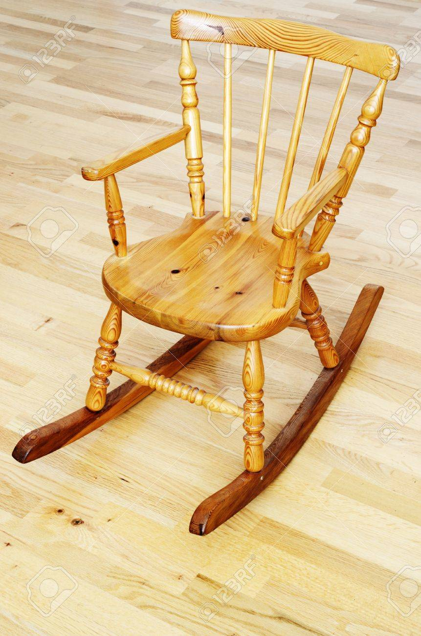 Picture of: Baby Carved Wooden Rocking Chair On The Parquet Floor Stock Photo Picture And Royalty Free Image Image 20322891