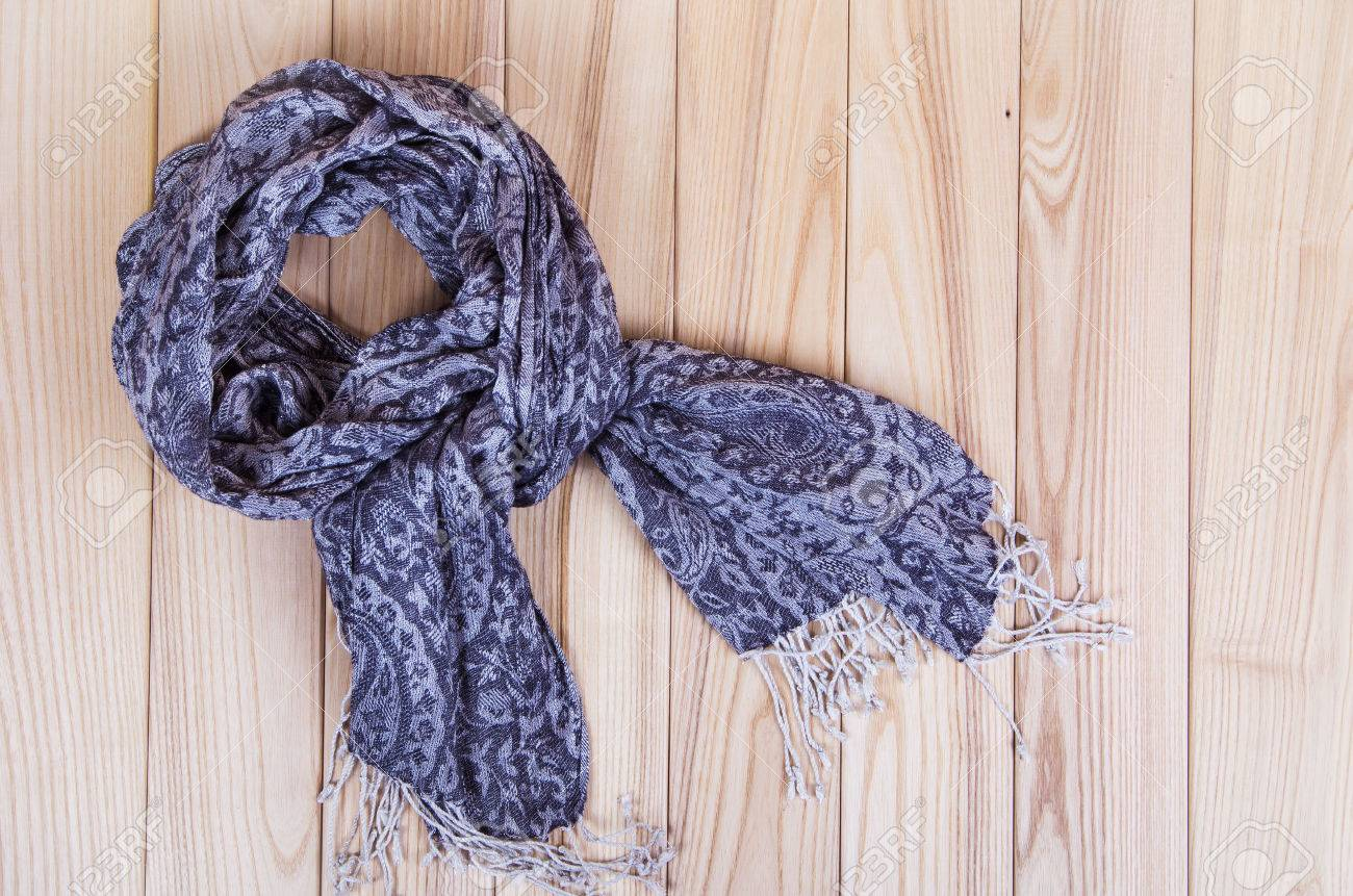gray scarf on wooden background - 38991574