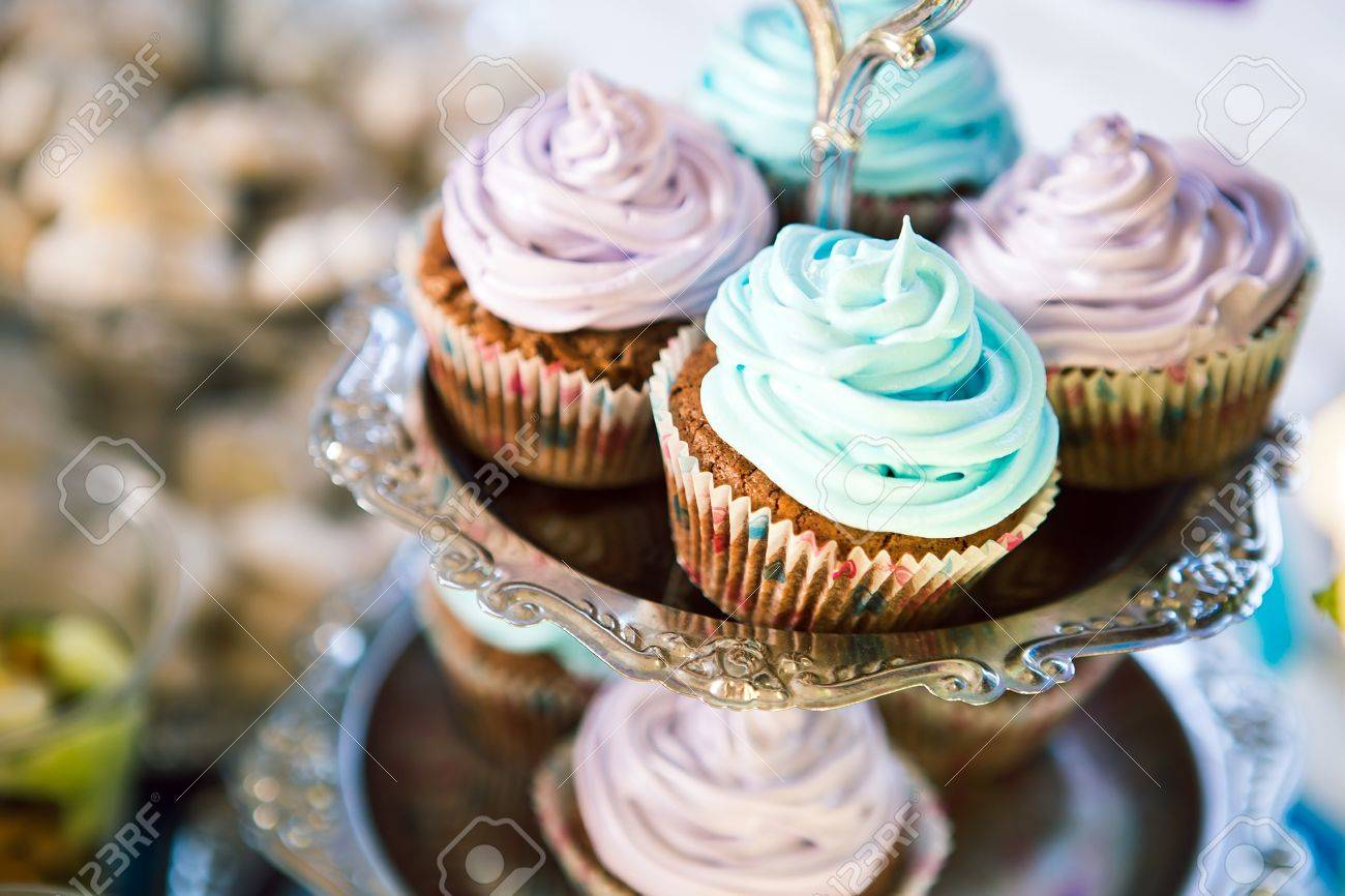 Delicious cupcakes on table on light background - 40858123