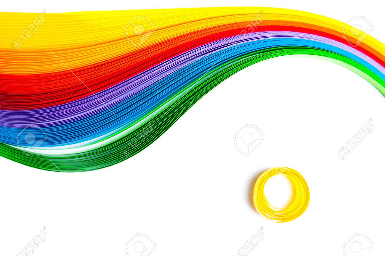Rainbow colored quilling paper laid out in waves and shapes - 42115551