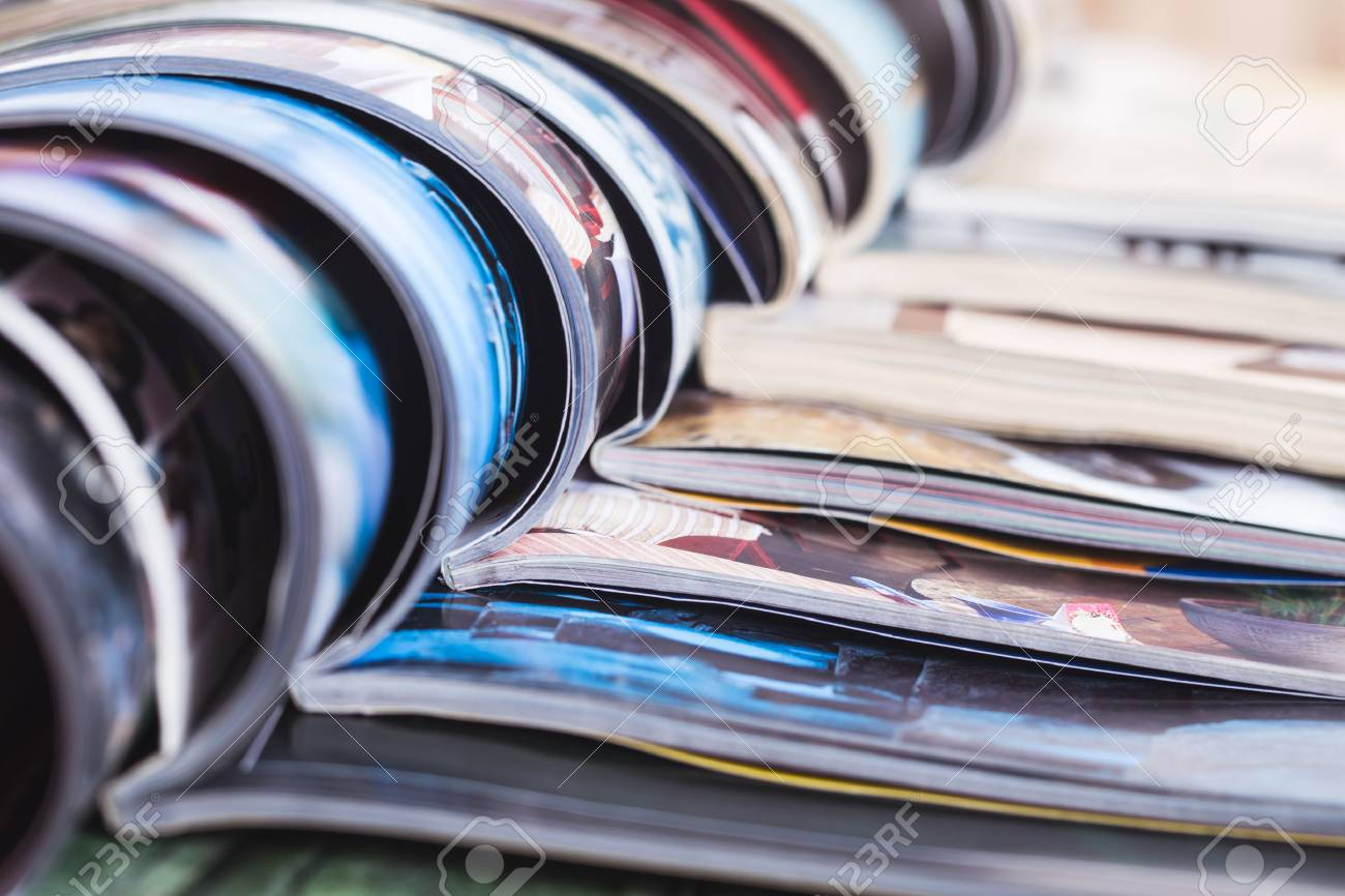 stack of open colorful magazines. information - 43405098