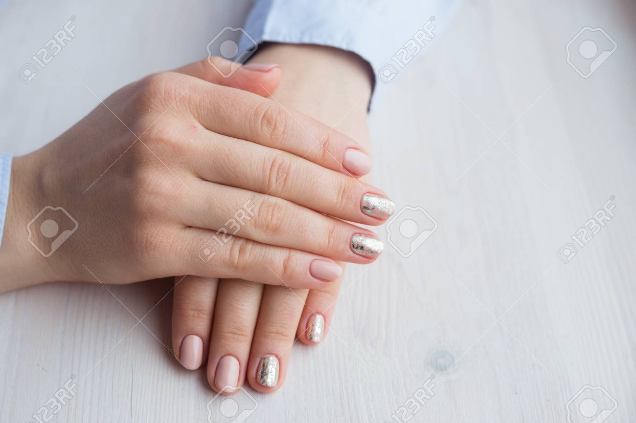 Female Hands With Manicure And Pink Polished Nails Stock Photo